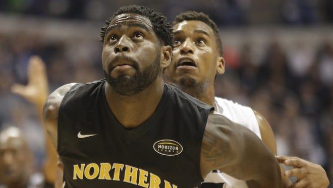 NKU's Jalen Billups battles Xavier's Trevor Bluiett for a rebound.