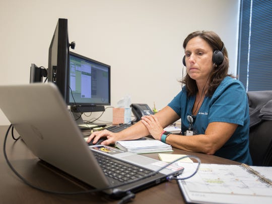 Lea Ann Coxwell, nurse practitioner, cares for a patient via live, interactive video from the Ridgeland offices of UMMC's Center for Telehealth.