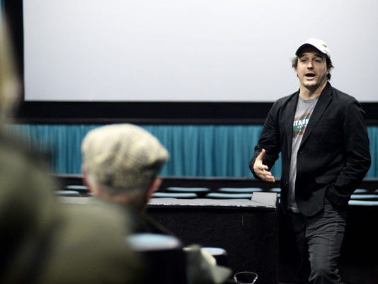 "Neal Dodson, who co-produced ""A Most Violent Year"", talks with movie-goers after they watched the film at Regal Cinemas in West Manchester Township in February."
