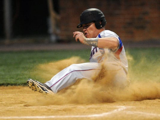 Spring Grove's Will Maughlin slides into home during the Rockets' 7-0 victory over Red Lion on Monday, May 6, 2013. YORK DAILY RECORD/SUNDAY NEWS--JASON PLOTKIN