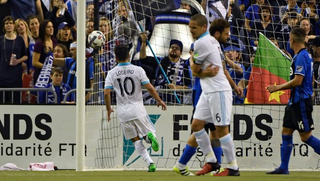 Seattle Sounders midfielder Nicolas Lodeiro (10) scores a goal against the Montreal Impact on a penalty kick.