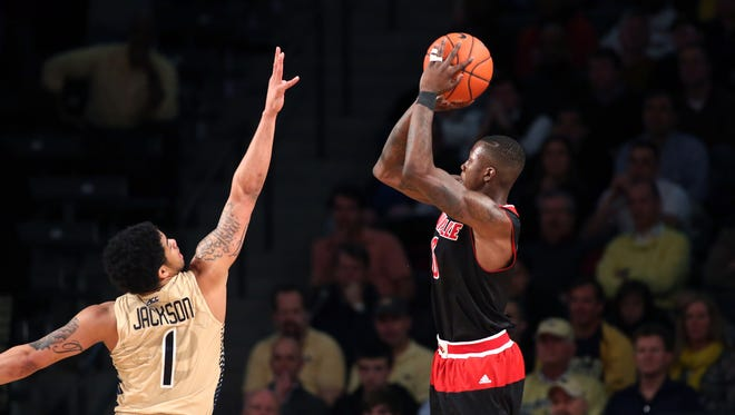 Feb 23, 2015; Atlanta, GA, USA; Louisville Cardinals guard Terry Rozier (0) attempts a shot defended by Georgia Tech Yellow Jackets guard Tadric Jackson (1) in the second half of their game at McCamish Pavilion. The Cardinals won 52-51. Mandatory Credit: Jason Getz-USA TODAY Sports