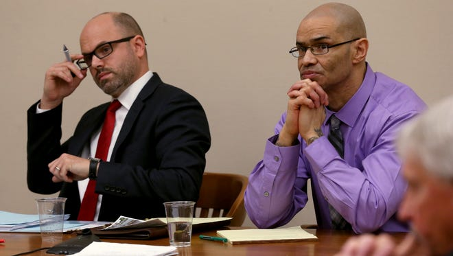 Defendant Jose Torres, convicted of a 2001 murder of Miguel Cruz with lawyer David Abbatoy.