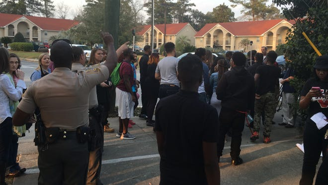 Police officers outside Donald Trump's rally Monday evening at Valdosta State University order a group of about 30 black students to leave the property. Secret Service agents a few minutes earlier had told the students Trump had requested their removal.