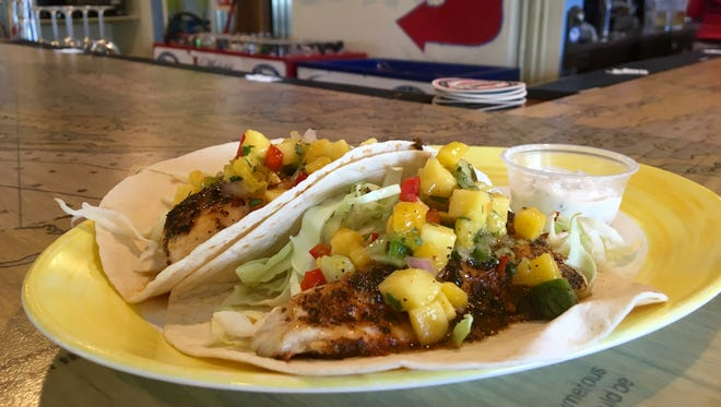 Blackened mullet tacos are a Hot Dish from Blue Dog Bar & Grill on Matlacha.