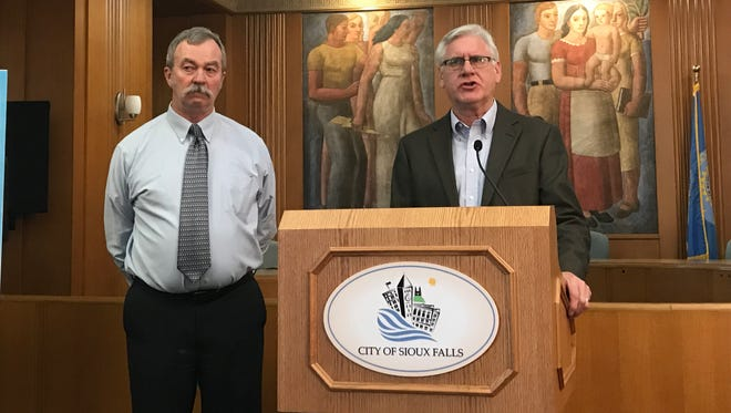 Ron Bell, Sioux Falls chief building services official, at left, and Director of Planning and Building Services Mike Cooper, at right, speak at a media conference Thursday.