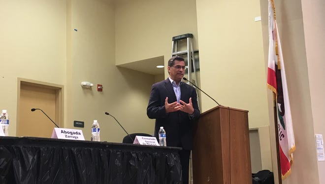 Attorney General Xavier Becerra speaks at Monday night's immigration forum