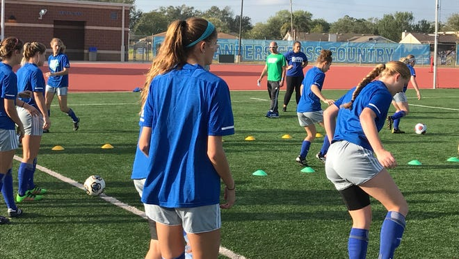Texas A&M-Corpus Christi coach Craig Shaw watches the Islanders work on a drill in preparation for the Southland Conference Soccer Tournament.