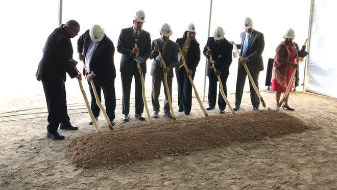Tohono O'odham Nation leaders use digging sticks at the groundbreaking of the Desert Diamond West Valley Casino near Glendale on Dec. 1, 2017.