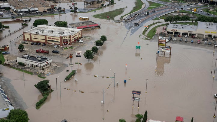 A shopping center in San Marcos, Texas, is swamped