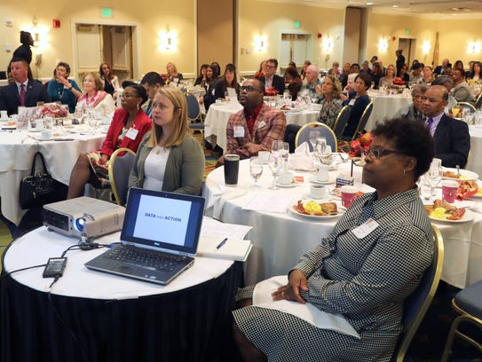 Attendees listen to speakers during the Westchester