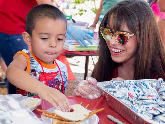 Ernesto Montano, 4, of Las Cruces, gets encouragement