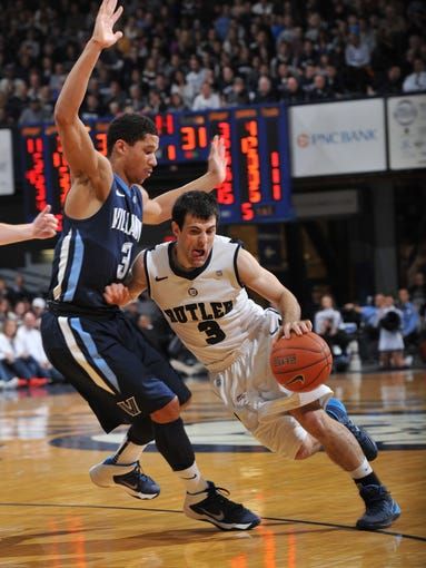 Butler's Alex Barlow drives against Villanova's James Bell in the second half as the  Villanova Wildcats beat the Butler Bulldogs 76-73 in overtime in the Bulldogs' Big East debut at Hinkle Fieldhouse Tuesday December 31, 2013.