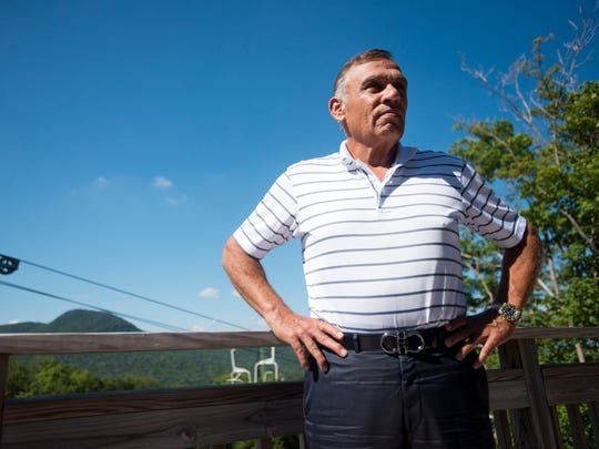 Ariel Quiros, who is co-owner of Jay Peak and is Bill Stenger's business partner, stands on the porch of his condo at Jay Peak in 2013.