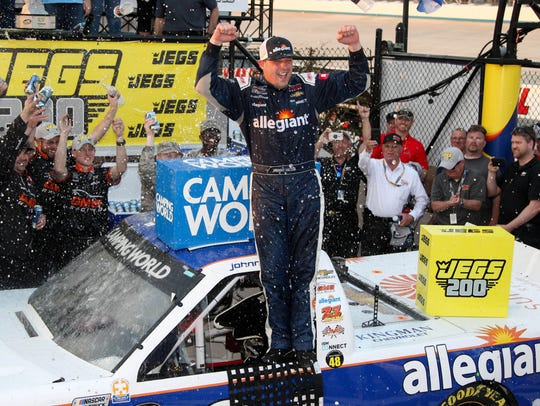 Johnny Sauter celebrates in victory lane after winning
