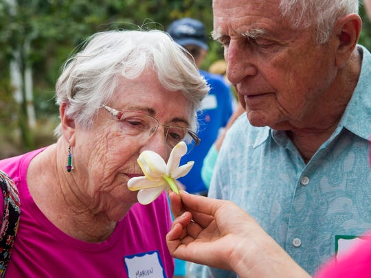 Marion Southard smells a gardenia during a therapeutic horticulture program at the Naples Botanical Garden on Tuesday, April 18, 2017. The program consists of a sensory tour of the gardens followed by a horticultural therapy activity, usually related to art and music.