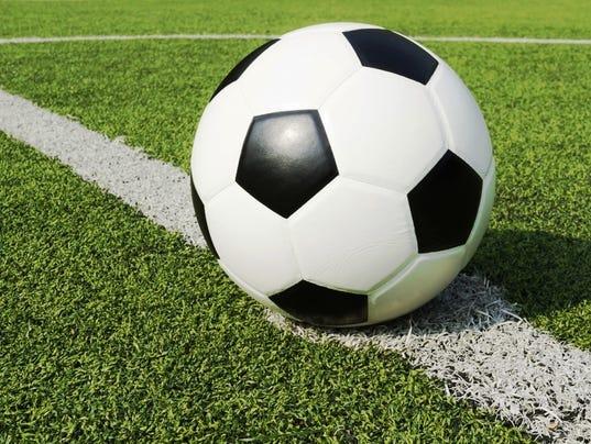 636077407062437693-soccer-ball-turf.jpg