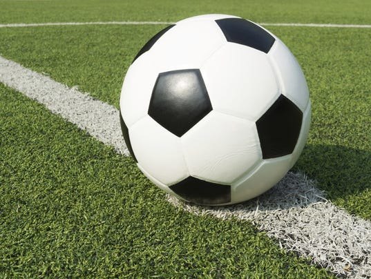 636078360632634355-soccerball-turf.jpg