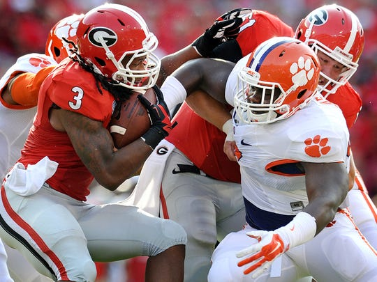 Clemson defensive tackle Grady Jarrett, right, moves in on Georgia tailback Todd Gurley last season.