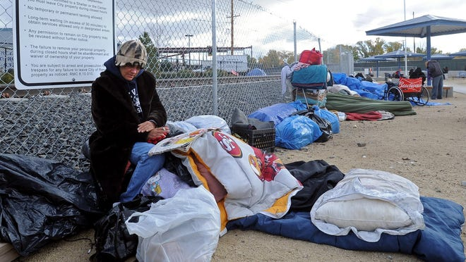 Tent city dwellers with their belongings at the current homeless shelter in Reno. Officials have opened a second shelter for the homeless population along the Truckee River.