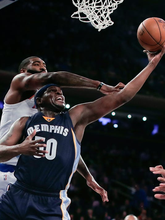 Memphis Grizzlies forward Zach Randolph (50) shoots against New York Knicks forward Kyle O'Quinn, top, during the second quarter of an NBA basketball game, Saturday, Oct. 29, 2016, in New York. (AP Photo/Julie Jacobson)