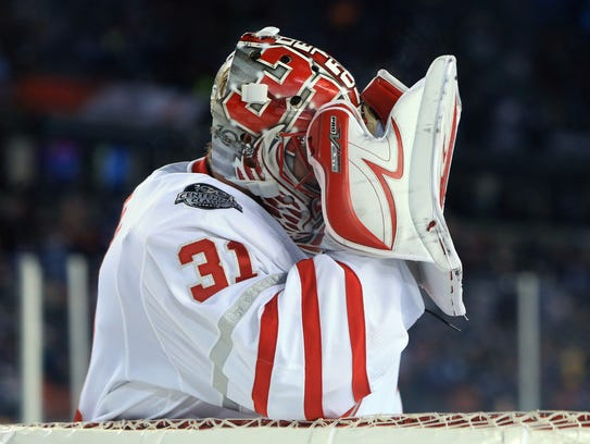 Red Wings goalie Jared Coreau holds his head after