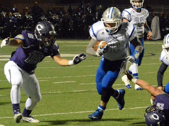 Carlsbad junior fullback Mark Sonora dashes to the