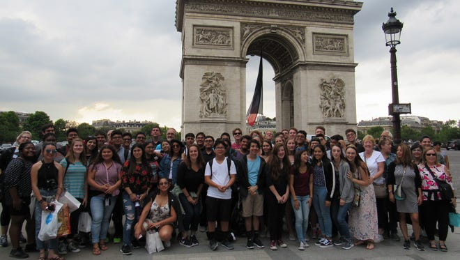 Desert Sands symphonic band students pose at the Arc de Triomphe during a recent visit to Paris, France, where they performed in concert.