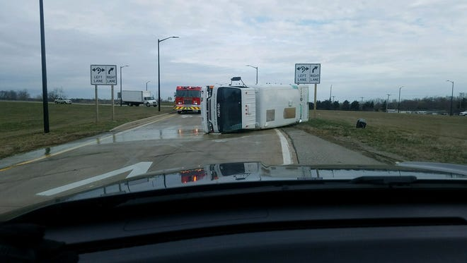 A fertilizer truck has rolled over and spilled chemicals on the roadway on M-53 and 26 Mile in Shelby Township.