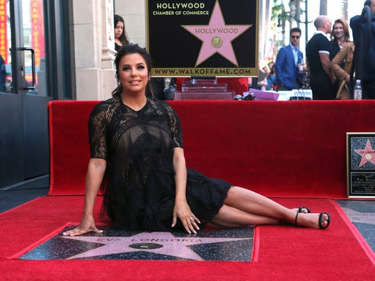 Eva Longoria poses with her star on the Hollywood Walk of Fame following a ceremony on Monday, April 16, 2018, in Los Angeles. (Photo by Willy Sanjuan/Invision/AP)