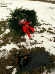 A wreath and yellow roses were left at the memorial