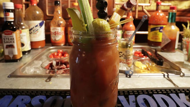 A finished cocktail is shown on the build-your-own Bloody Mary bar at RumRunners, which is known for the classic drink made with tomato juice, vodka and assorted garnishes.