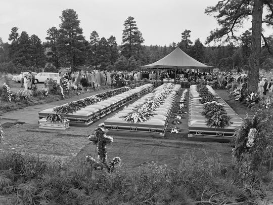 Nearly four hundred relatives and friends of the 70 people who died in the crash of a TWA Super-Constellation over the Grand Canyon June 30, 1956 attend a mass funeral service in Flagstaff, Ariz. Sixty-seven caskets were lowered into a common grave on July 8, 1956.