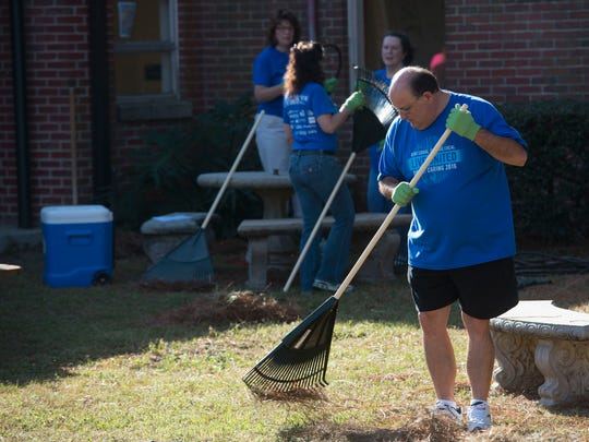 Bill Stott volunteers his time at O.J. Semmes during Friday's United Way Day of Caring. Florida Blue, Big Brothers and Big Sisters of Northwest Florida and the Pensacola News Journal also participated in projects at the school.