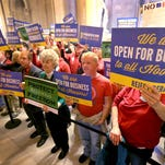 Supporters and opponents of Senate Bill 1010, the religious freedom bill, stand outside the House chambers on March 19.
