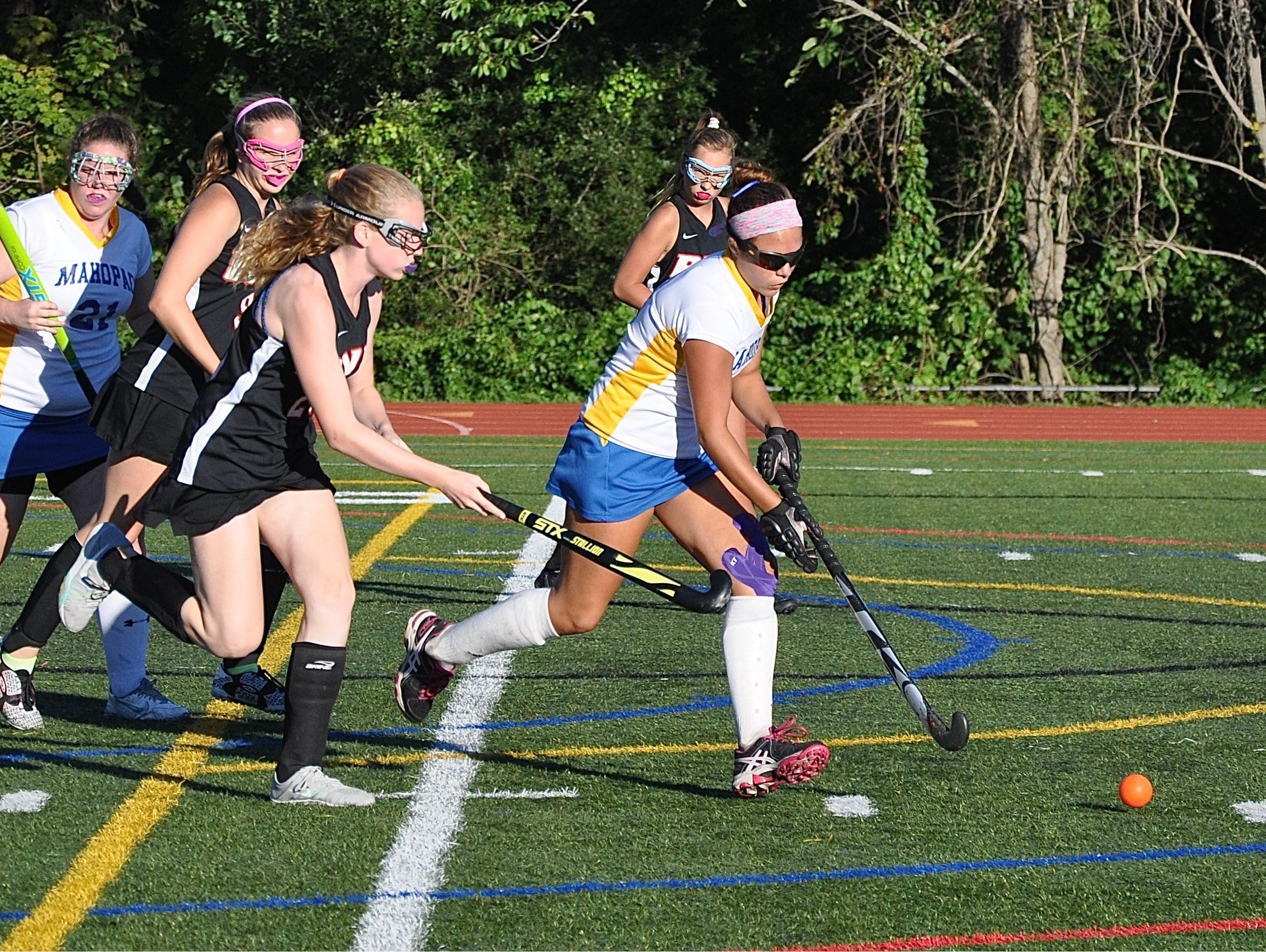Dominique Milian breaks the ball out of the Mahopac defensive zone, chased by Rye's Catherine Egan. Photo from Sep 12, 2016.