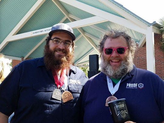 Proof Brewing Company lead brewer David Kant, left,