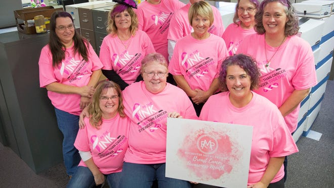 """The staff of Great States Corp and American Lawn Mower Co. wear pink on Oct. 27 for the annual """"In the Pink Day,"""" as a part of Breast Cancer Awareness Month."""
