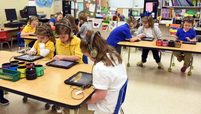 Kindergartners at Sumrall Elementary practice learning techniques on their iPads. The students took the fall kindergarten readiness assessment.