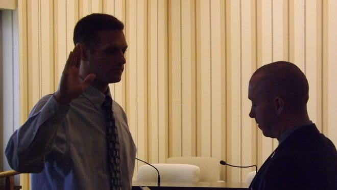 Jourdan Brouse is sworn in as a new Richmond Police Department officer by Mayor Dave Snow.