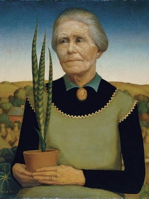 """In Grant Wood's painting """"Woman With Plants,"""" this snake plant is a focal point in the work."""