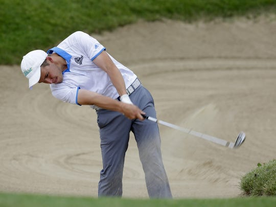 Chris Colla, of Winnebago Lutheran Academy, chips out of a bunker during the second day of the Division 2 WIAA State Golf Tournament at University Ridge in Madison, June 7, 2016.