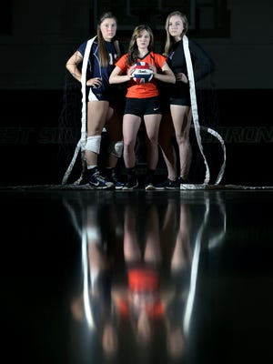 The El Paso Times' all city volleyball players are setter Alyssa Heist of Coronado, left, defensive player Tayler Kennedy of El Paso High, center, and hitter Caylee Robalin of Franklin.