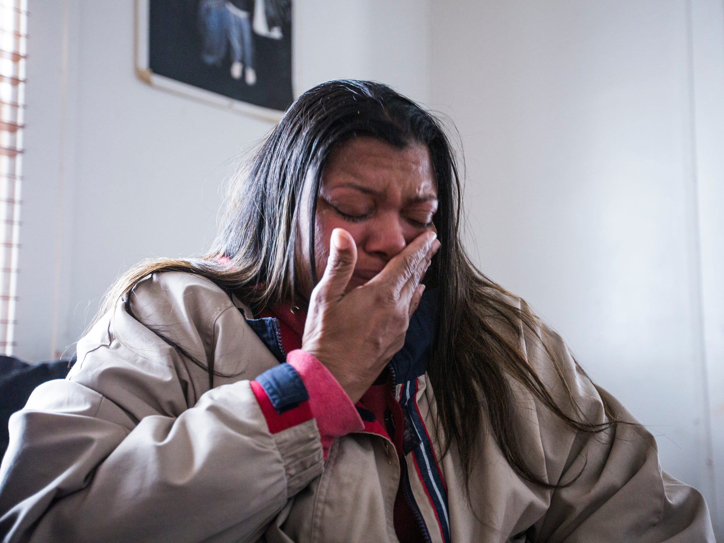 Earnestine Havvard tries to hold back tears while discussing her son and stepsons that were gunned down on the streets of Indianapolis.