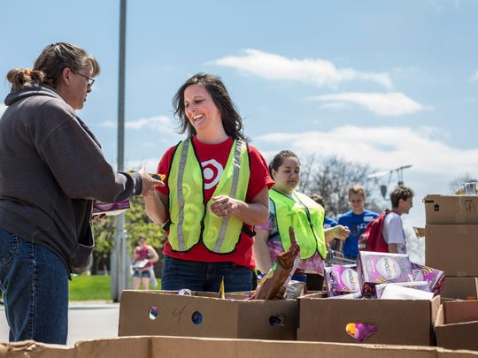 Lisa Gronek, a volunteer from Target, helps hand out food during the Community Resource Fair Wednesday, May 11, 2016 at St. Clair County Community College.