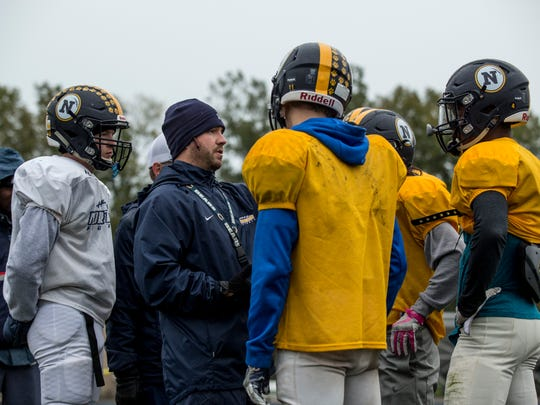 Coach Larry Roelens talks with players in a huddle during practice Wednesday, Oct. 26, 2016 at Port Huron Northern High School.