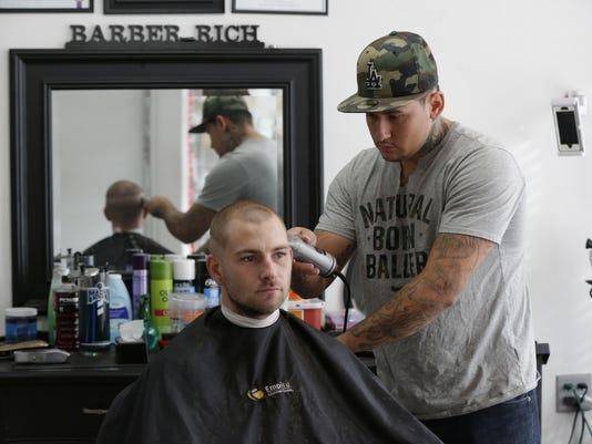 Barber Rich Mitchell cuts hair