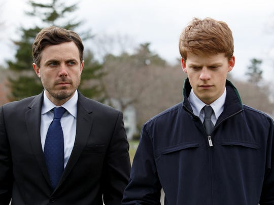 "Casey Affleck, left, and Lucas Hedges in a scene from ""Manchester by the Sea."""