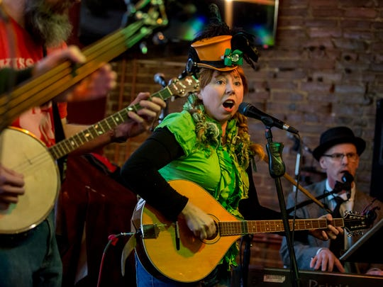 Members of Detroit area band McSpillin' perform during the pub crawl Saturday, March 11, 2017 at Lynch's Irish Tavern in Port Huron.