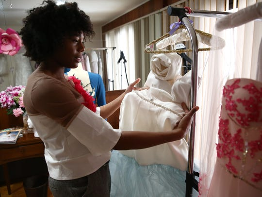 Jasmine Terry-Ankobil, owner of Laidiecloth holds a